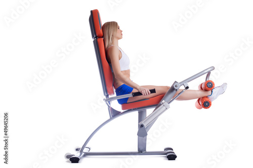 Beauty woman sitting on orange hydraulic exerciser