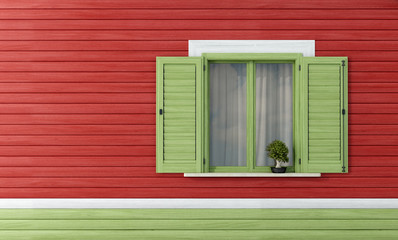 Green windows on red wooden wall