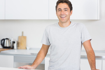 Smiling man in kitchen