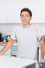 Handsome man in kitchen