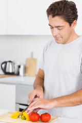 Man slicing vegetables