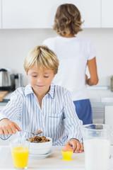 Young boy having breakfast