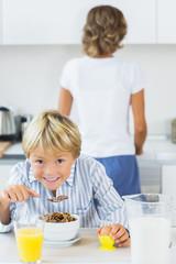 Happy boy having breakfast