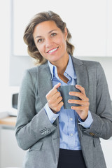Happy woman having coffee