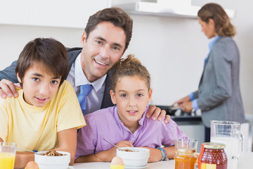 Father and children at breakfast
