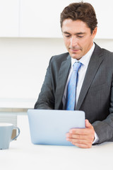 Man using tablet pc before work