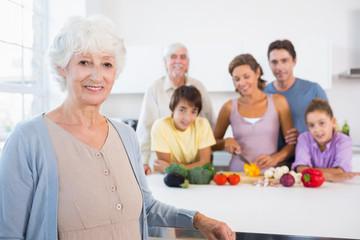 Grandmother standing beside kitchen counter
