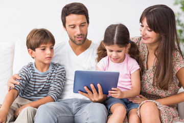 Happy family looking at tablet pc
