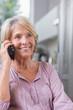 Smiling mature woman calling