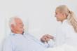 Doctor comforting elderly patient
