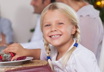 Little girl smiling at christmas