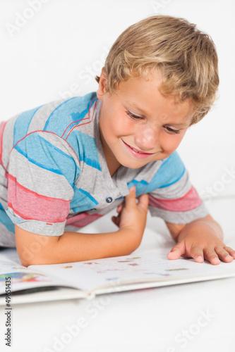 Happy boy reading a storybook