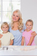 Blonde smiling family at the camera