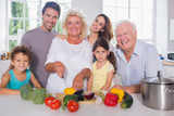 Multi-generation family cutting vegetables together