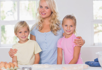 Blonde family smiling at the camera