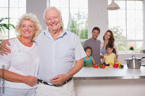 Grandparents in front of their family
