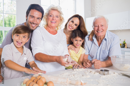 Smiling family baking together