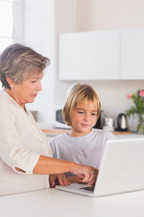 Granny and grandson looking at laptop