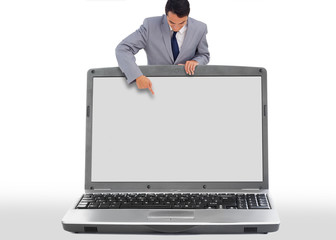 Businessman pointing down to blank laptop screen