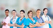 Female hospital workers standing arms folded