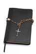 Rosary beads wrapped around the bible