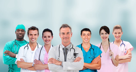 Mixed group of medical workers standing arms crossed