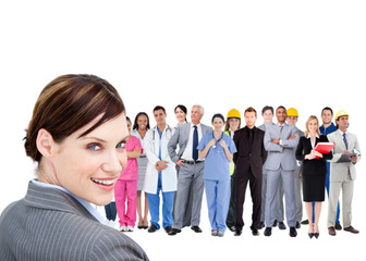Smiling businesswoman ahead a group of people with different job