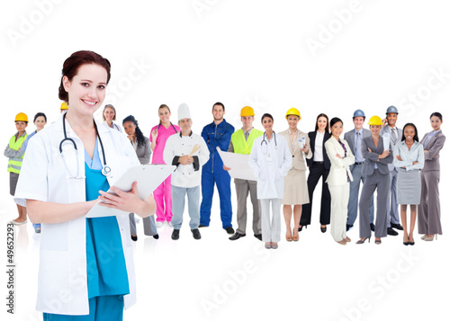 Pretty doctor standing in front of diverse career group