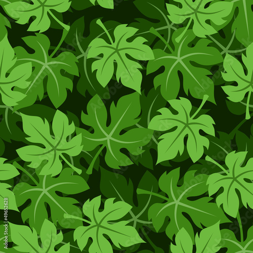 Seamless background with grape leaves. Vector illustration.