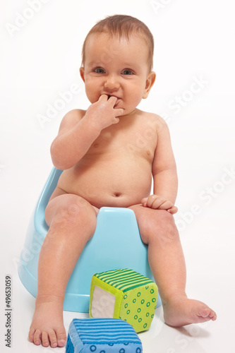 baby boy sitting on potty