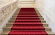 Leinwanddruck Bild - Prachtvolle rote Treppe mit rotem Teppich