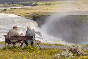 Two man on wooden bench - Iceland.
