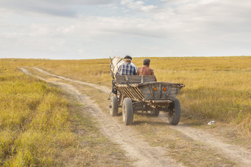 Two man on old cart - Ukraine.