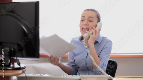Businesswoman screaming  by telephone, slow motion