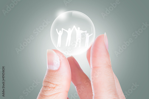 Hand with the paper cut of the family in bubble