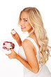 Beautiful blonde woman holding a tub of ice cream