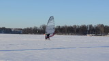 follow ice surfer man catch wind sail frozen lake winter sport