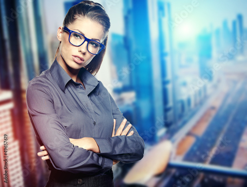 Portrait of cute young business woman outdoor over building back