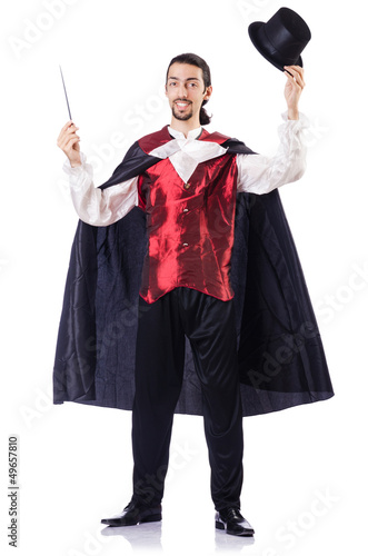 Magician with his magic wand on white