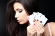 Portrait sensual girl with four aces