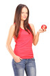Beautiful young woman holding a red apple