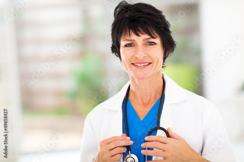 pretty female middle aged medical worker portrait in office