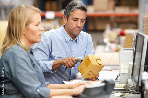 Poster Industrial geb. Business Colleagues Working At Desk In Warehouse