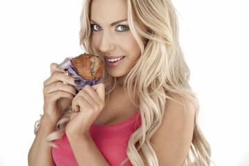 Beautiful woman eating a muffin
