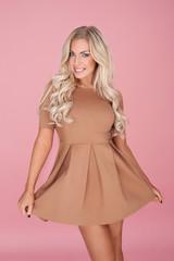 Elegant blonde woman in a miniskirt