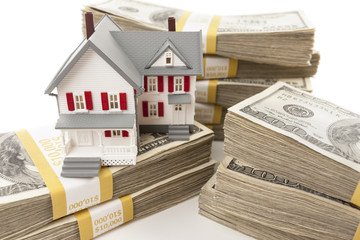 Stacks of Hundreds of Dollars with Small House