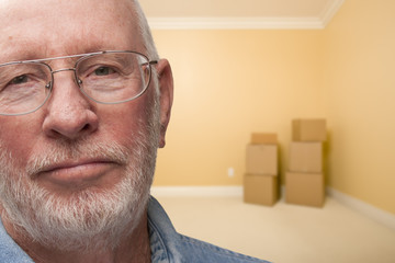 Sad Older Man In Empty Room with Boxes