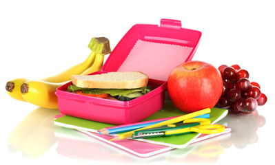 Lunch box with sandwich,fruit and stationery isolated on white