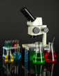 Test tubes with colorful liquids and microscope