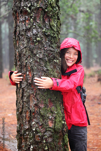 Happy girl tree hugger